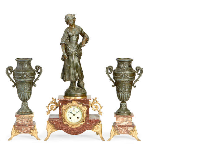 An early 20th century French spelter, marble and gilt metal figural clock garniture