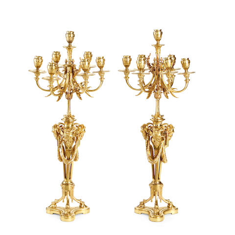 A pair of third quarter 19th century French gilt bronze candelabra by Marny Hag, Paris