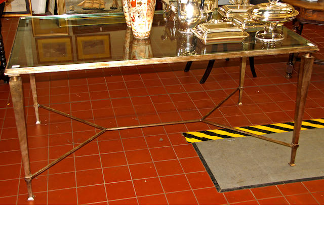A modern silvered metal frame dining table,