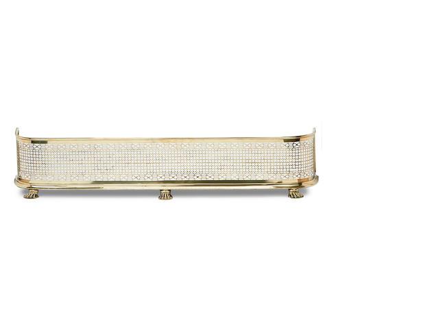 A late Regency pierced brass fender