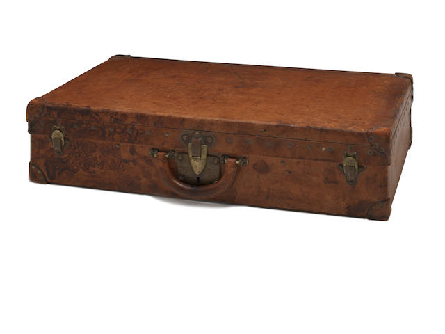 LOUIS VUITTON: A brown leather travelling  case circa 1920