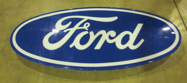 A large Ford illuminating showroom sign,
