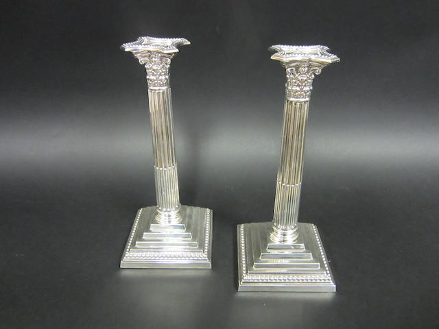 A silver pair of Corinthian column candlesticks by James Dixon & Sons, Sheffield 1940