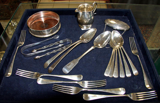 A set of six silver table forks and dessert spoons,
