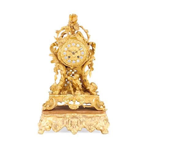 A mid 19th century French Rococo Revival gilt bronze mantel clock