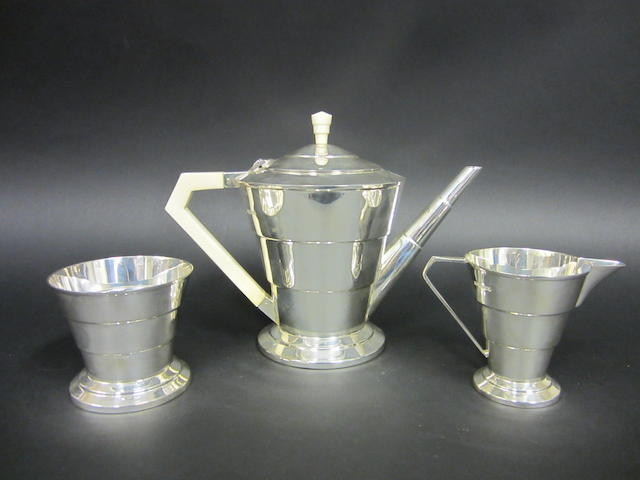 An Art Deco silver and ivory handled three piece tea service by Viners, Sheffield 1934, Coronation duty mark