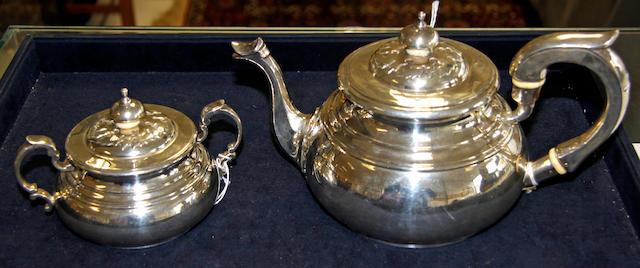 A silver tea pot and sucrier,