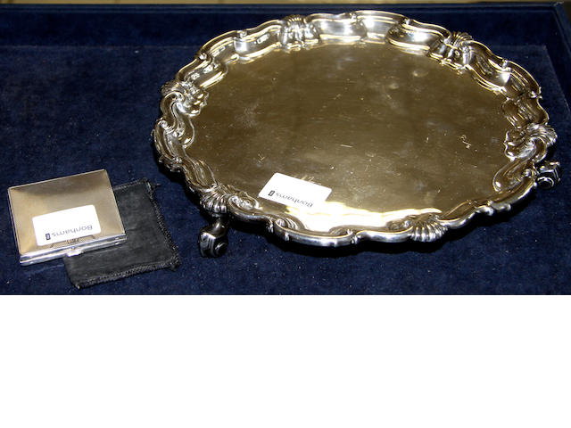 A silver salver,with scalloped border on scrolled feet, Sheffield 1924, weight 20ozs and a silver compact, Birmingham 1922 (2).