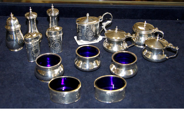 Three assorted silver table cruet sets