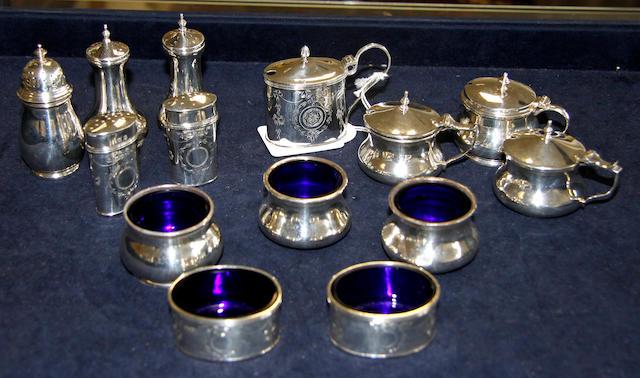 Three assorted silver table cruet sets