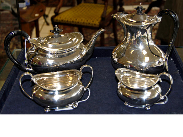 A silver matched four piece tea set