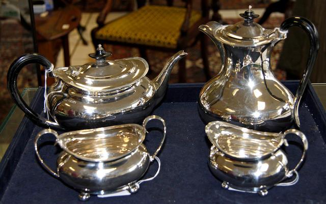 A silver matched four piece tea set