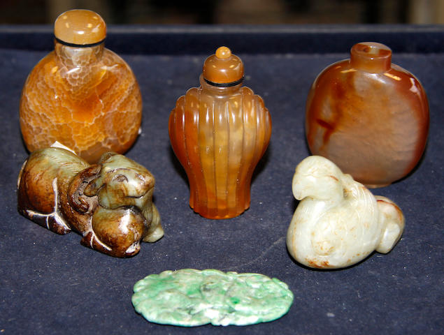 Three Chinese agate snuff bottles,an emerald green carved jade pendant and a carved jade goat, 6cm and a jade bird, 5cm (6)