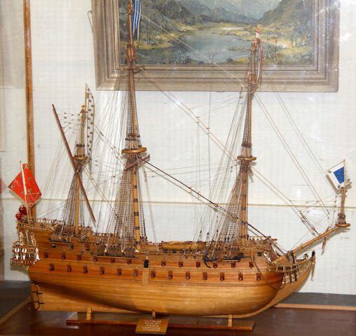 A wooden scratch built scale model of a war ship Le Mirage by D H Paynter, St Ives, Cornwall 85cm high x 85cm long