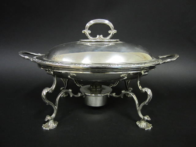 An Edwardian silver oval two-handled, three-part entree dish on plated stand by Heath & Middleton, London 1906