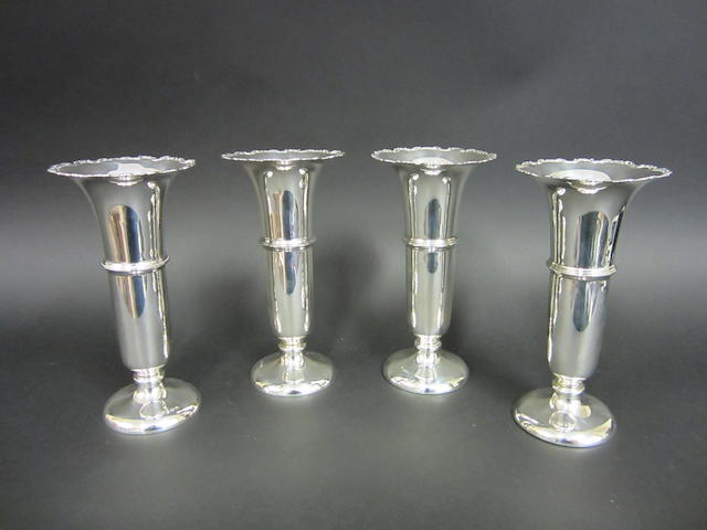 A silver set of four tapering vases by William Neale & Son Ltd., Birmingham 1925