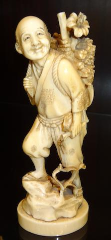 A carved Japanese ivory figure of a woodcutter