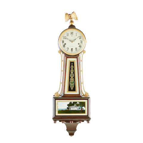 A 1920's New Haven mahogany and gilt metal mounted wall chiming wall clock