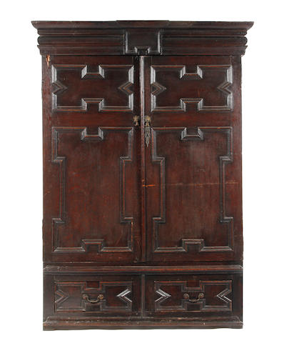 An 18th century oak livery cupboard