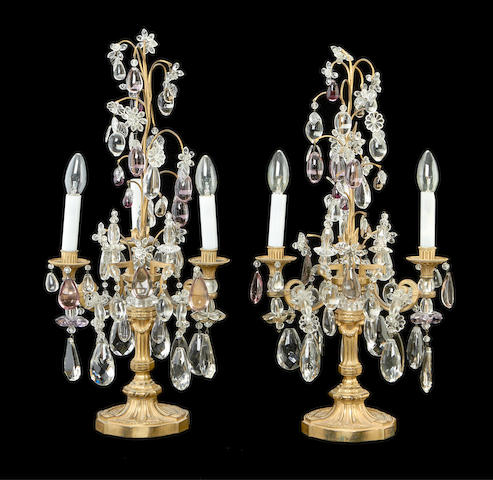 A pair of late 19th century gilt bronze, cut and amethyst glass candelabra