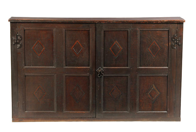 An oak and pine two-door cupboard Incorporating 17th century timbers