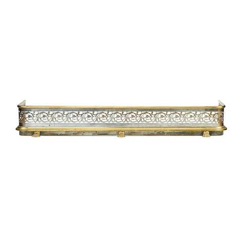 A 19th century brass and pierced steel fender