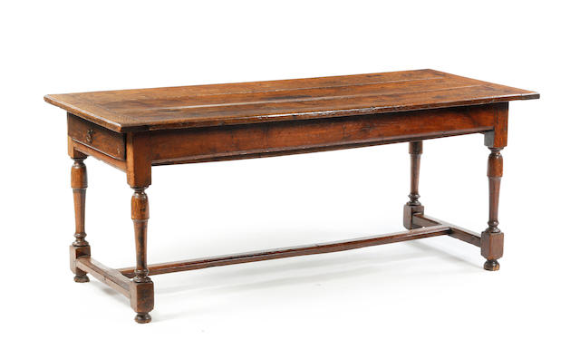 An 18th century oak and elm farmhouse-type table