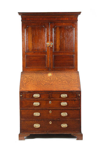 A George III oak bureau cabinet