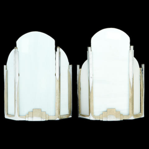 A pair of silvered metal and frosted glass uplighters