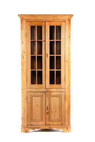A pine standing corner cupboard