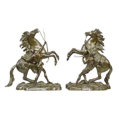 After Guillaume Coustou, French (1677-1746)  A pair of late 19th century French bronze models of the Marley horses