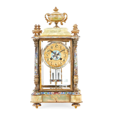 A late 19th century French onyx, gilt metal and champlevé enamel four glass clock