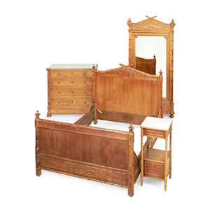 A four piece suite of French second quarter 19th century birds' eye maple and simulated bamboo bedroom furniture