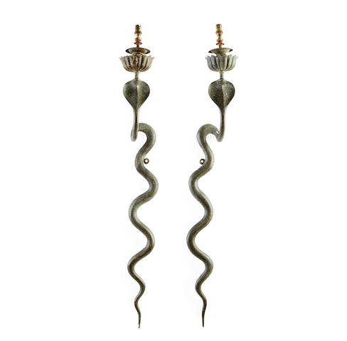 A pair of early 20th century Middle Eastern etched bronze wall lights modelled as cobras