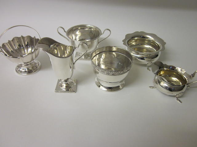 A matching silver cream jug and sugar bowl by Horace Woodward Sheffield 1911/12,  (6)