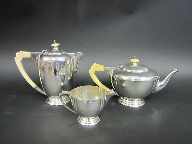 An Art Deco silver three piece circular tea service by the Barnards, London 1936