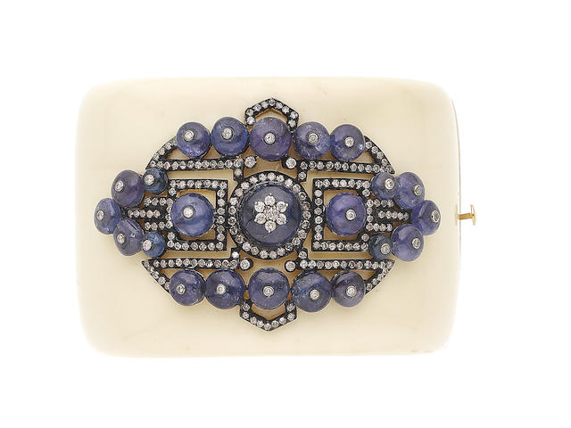 A bakelite, tanzanite and diamond hinged bangle (illustrated above)