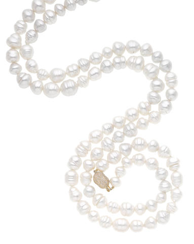 A cultured pearl and diamond long necklace (illustrated above)