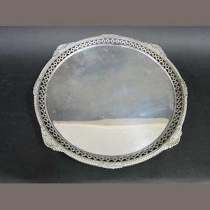 A silver circular salver by Pearce & Sons, London 1916