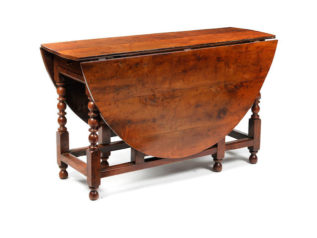 An early 18th Century yew gate-leg table