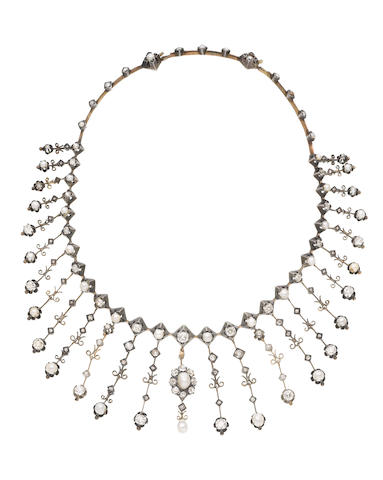 A pearl and diamond fringe necklace (illustrated inside the back cover)