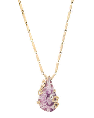 A gold, amethyst and diamond pendant necklace, by Grima, (illustrated inside the front cover)