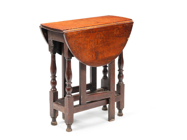 An early 18th century oak gateleg occassional table