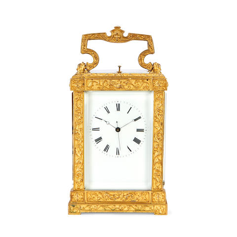 A late 19th century French gilt brass carriage clock with repeat