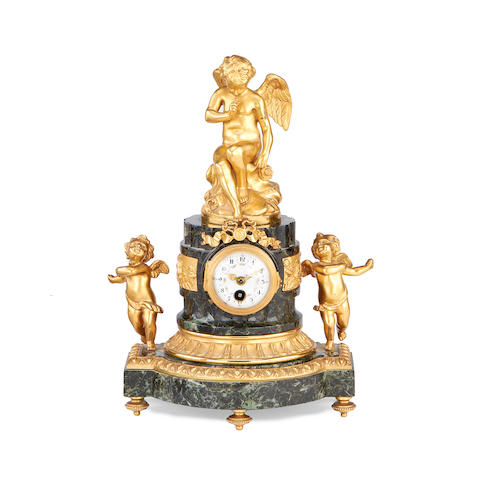 An early 20th century gilt metal and marble timepiece surmounted by a figure of Cupid after Falconet