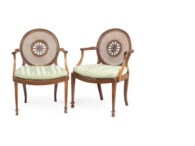 A pair of Victorian mahogany caned armchairs in the George III style