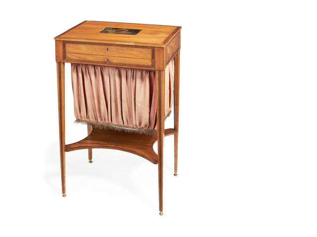 A late George III satinwood, purplewood and gilt decorated black lacquer inset work table