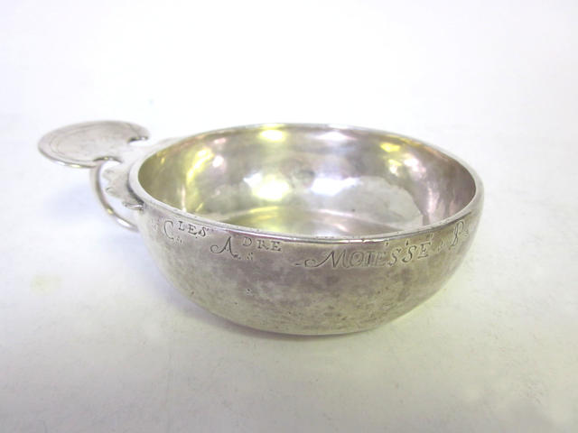 A late 18th century French provincial silver wine taster stamped once 'LB' with crown above and twice 'III LL P' spread over three lines with crown device above