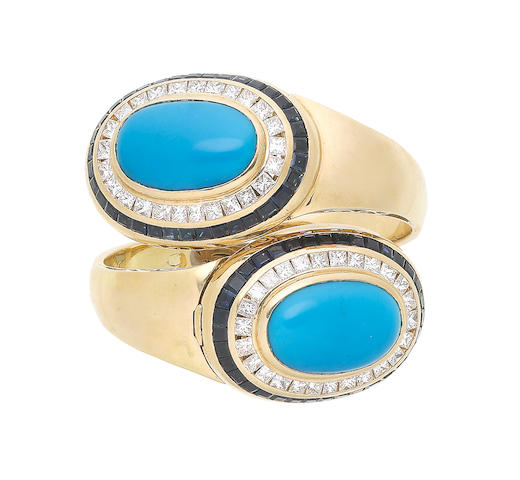 A turquoise, sapphire and diamond hinged bangle (illustrated above)