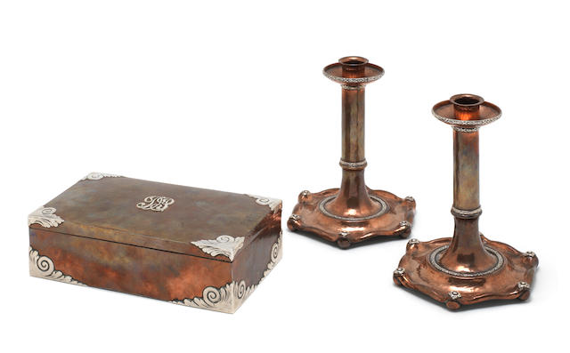 A 20th century silver-mounted and copper  box in the arts and craft style; together with a similar pair of candlesticks (3)